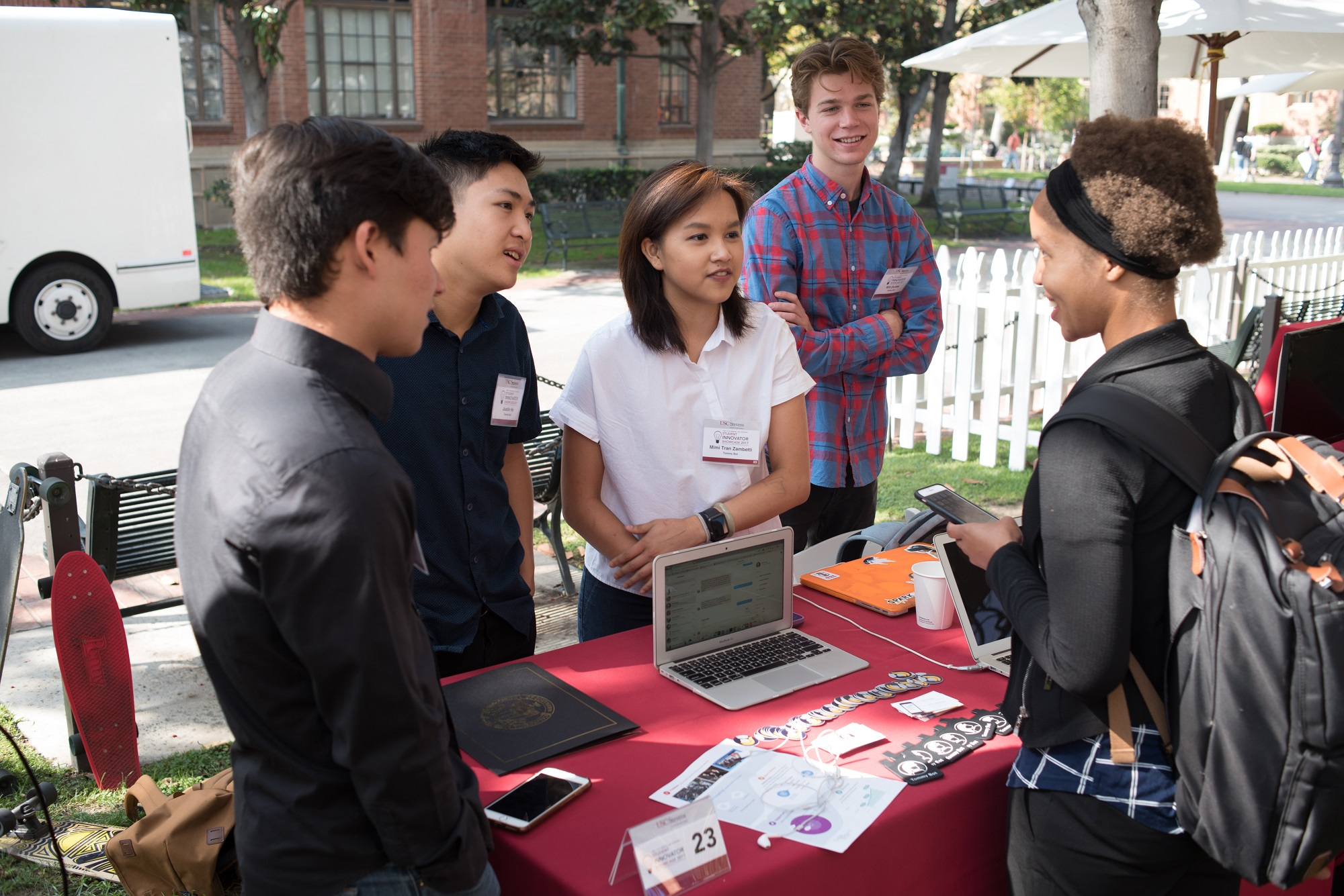 Student team talking to Showcase attendee