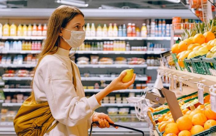 Woman wearing mask in grocery store